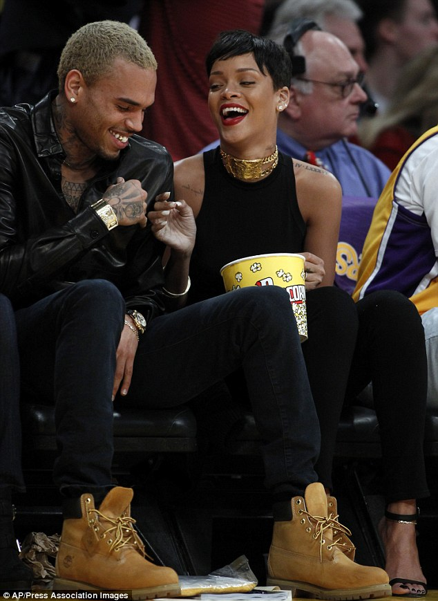 Happy holidays! Rihanna and Chris spent Christmas Day together, front row at a Lakers' game