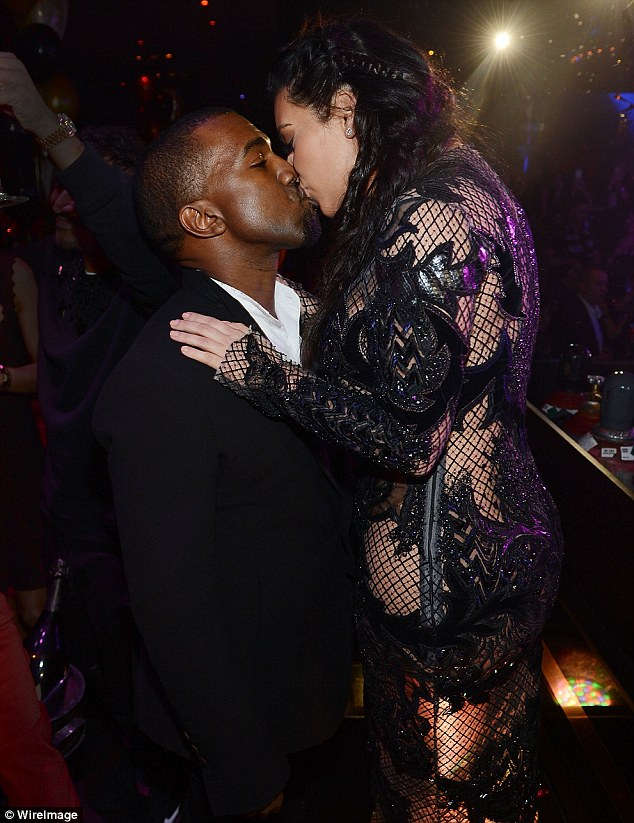 Parents to be: Kim and Kanye kiss as they see the New Year in together, causing her fans to chastise her for being in a club while pregnant