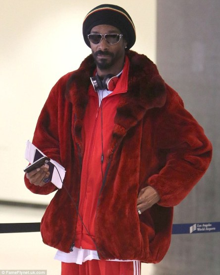 That's the way to travel! Snoop Lion - aka Dogg - arrived at LAX in a full red fur suit on Wednesday