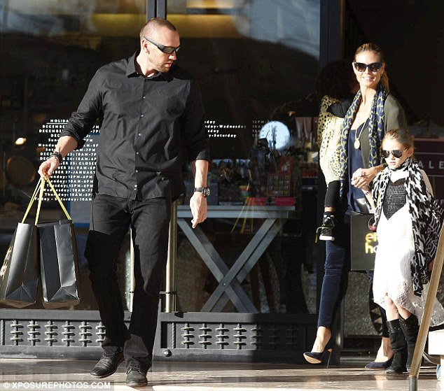 The benefits of a security detail: Heidi made sure Martin Kristen was left to carry the larger bags