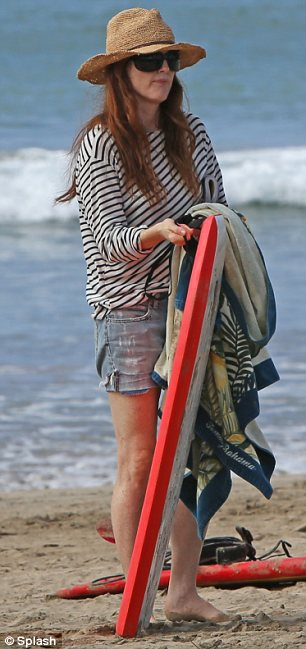 On hand to help: The actress was seen holding on to the board and a towel