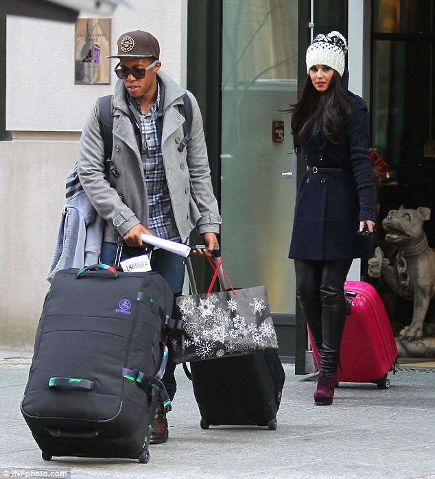 Weighed down: the couple, who began dating six months ago, had a lot of luggage and Tre wheeled most of it out on his own