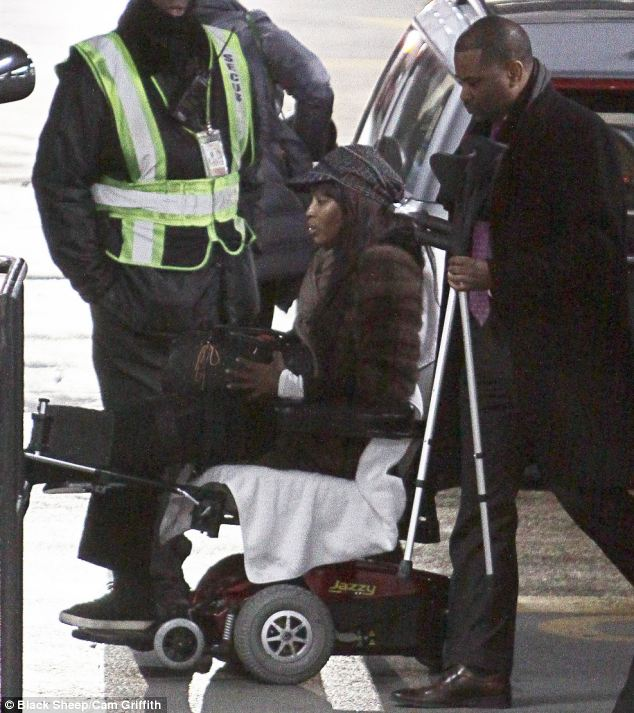 Supermodel Naomi CAmpbell uses a wheel chair follwoing her alleged assault in the streets of Paris on Nov 21