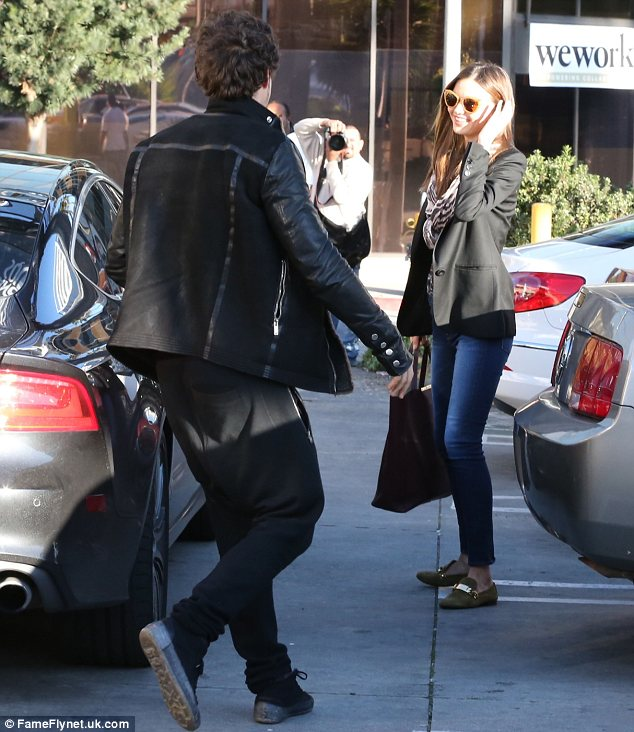 Orlando Bloom rushes to open the car door for wife Miranda Kerr after picking the Victoria's Secret model up from her day at an exclusive LA spa