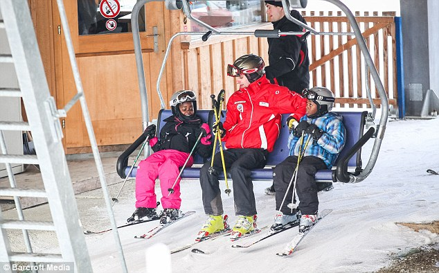 Fun times: David and Mercy were seen laughing and smiling as they climbed aboard a ski lift with their instructor