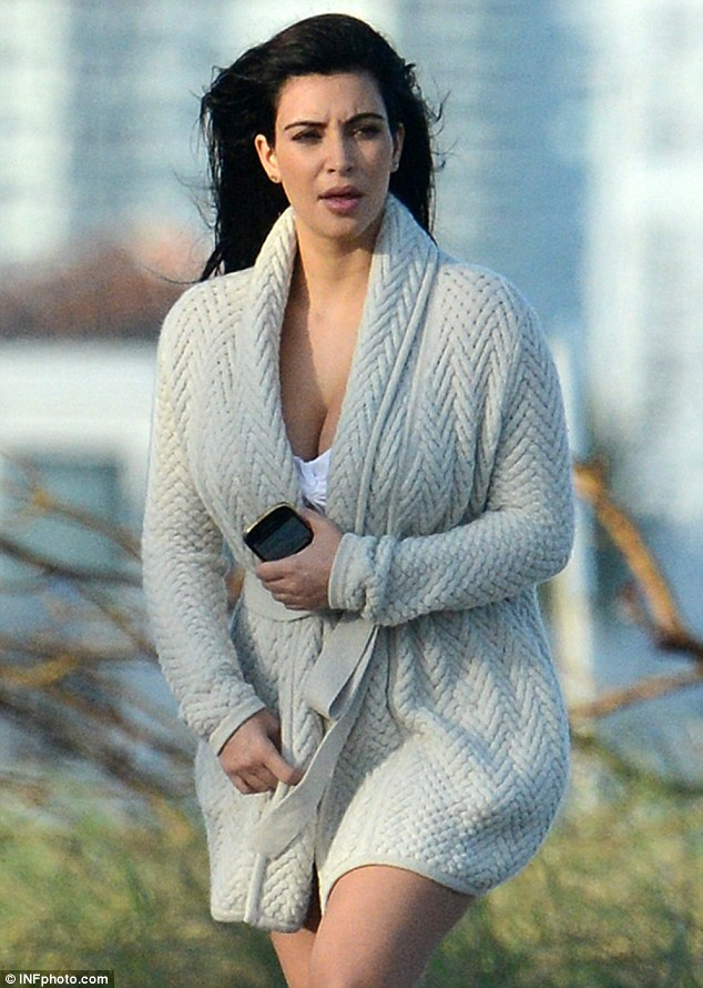 Keeping her kurves hidden: Kim did her best to conceal her growing figure as she prepared for the shoot