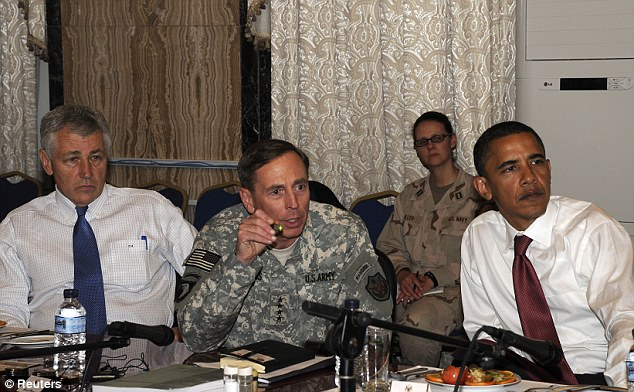 Working together: Hagel, left, and Obama, right, listen as the now-disgraced General David Petraeus reviews operations in Iraq to a congressional delegation visiting Baghdad in July 2008
