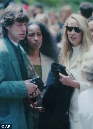 Mick Jagger pictured with Marsha Hunt and Jerry Hall