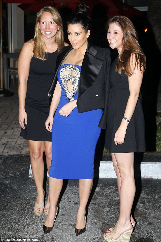And pose: Kardashian posed for photographs as she made her way back home for the evening