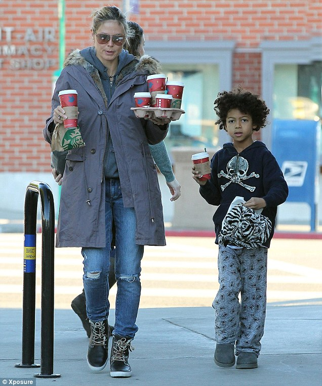 Mommy's little helper: Heidi picks up coffees with the help of her son