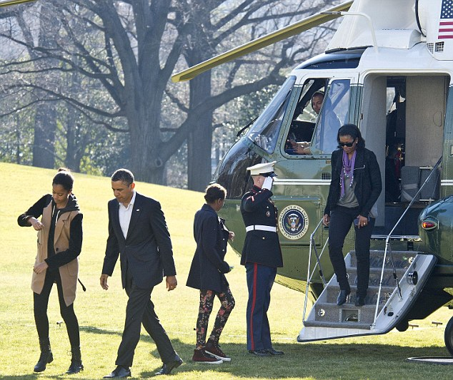 Strict control: The Obamas land back at the White House on January 6. The first couple are strict with press access to their two daughters