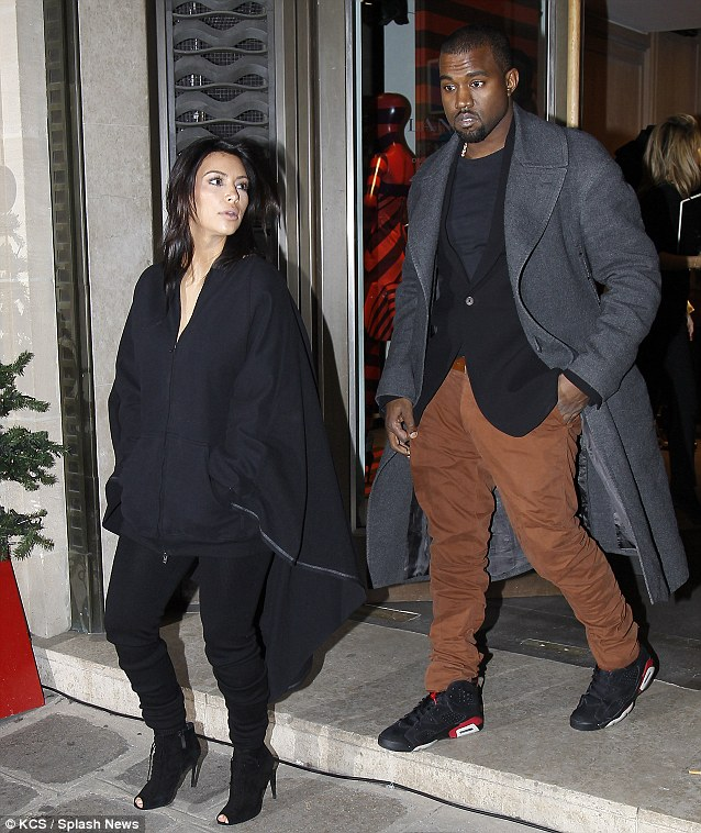 How do I look? Kim chats to Kanye as they leave the store