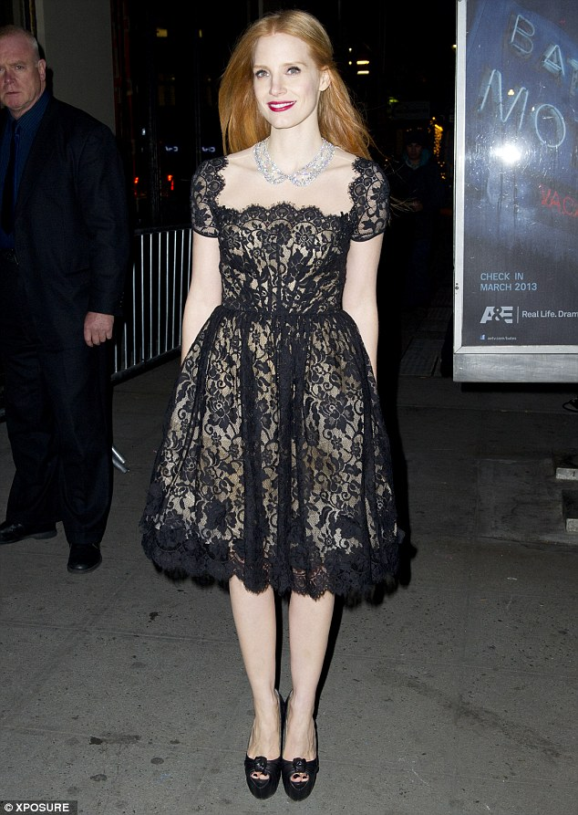 Lovely in lace: Jessica Chastain looked fantastic in her black lace dress and blinding diamond collar necklace