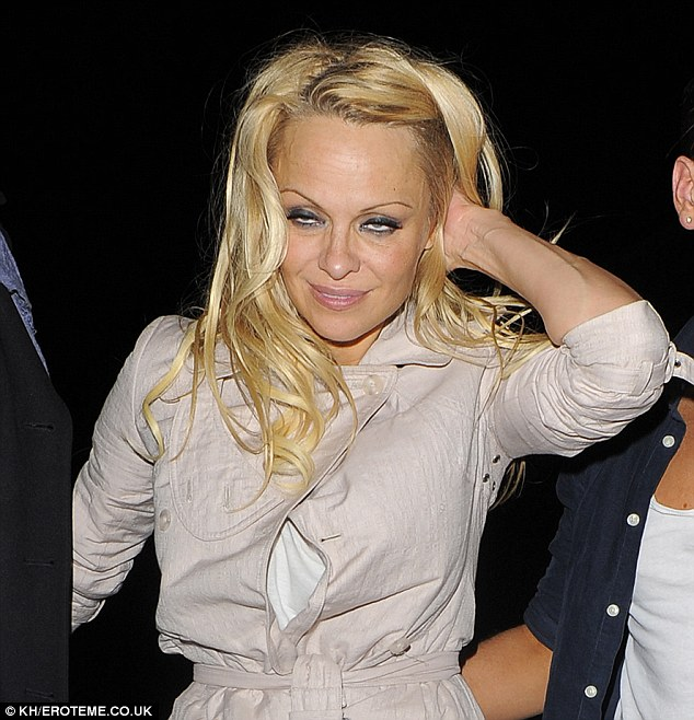 Good night was it? Pamela Anderson appears worse for wear after night out following her Dancing On Ice early exit on Sunday