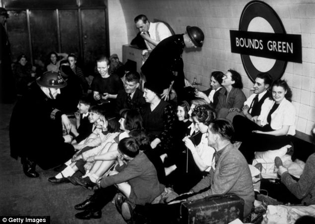 War-time: London residents are pictured sheltering from air raids at Bound's Green Underground station, in December 1940