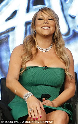 Bursting out: Both Mariah and Nicki seemed to be competing for the most revealing dress award