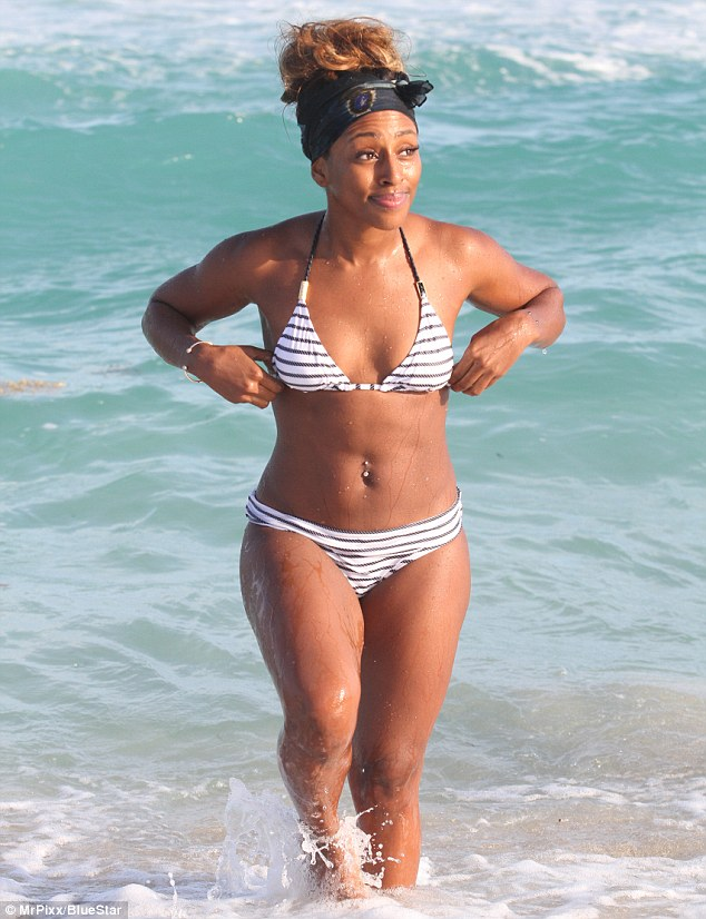 Beach babe: Alexandra Burke cools off in a black and white bikini as she soaks up the sun in Miami, Florida