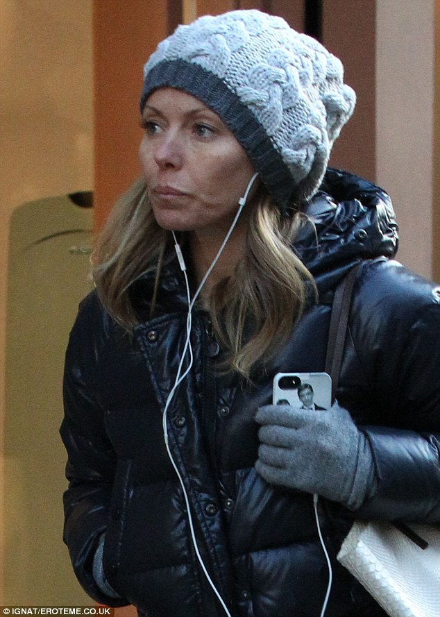 Keeping warm: But she kept warm in a large black padded jacket, a pair of Ugg boots, a beanie hat and matching gloves