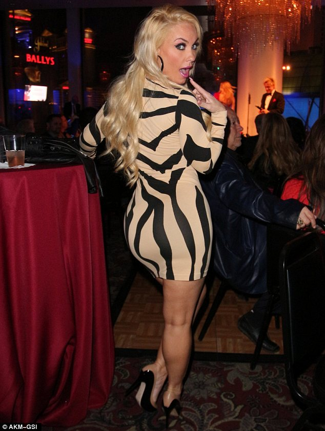 Dangerous curves ahead: Coco showed off her voluptuous form in a very tight dress at the Zowie Bowie and Friends Opening Night on Tuesday