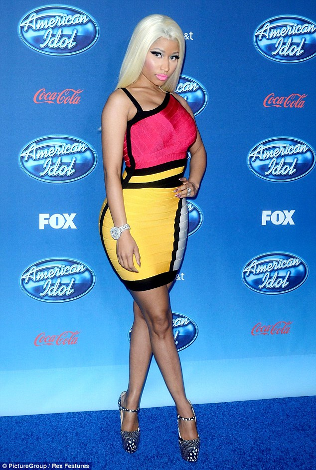 Show stopper: Nicki Minaj stole the spotlight at the American Idol Season 12 Premiere in Los Angeles by wearing this clingy neon pink and yellow dress