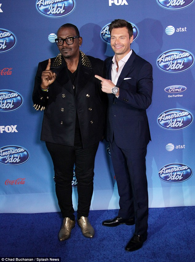 All that glitters: Randy Jackson outshone Ryan with his gold-studded suit and pointy gold shoes