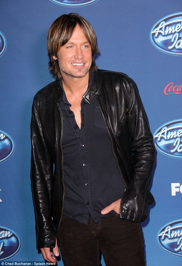 Country chic: Keith Urban cut a dashing figure in black leather jacket and brown jeans