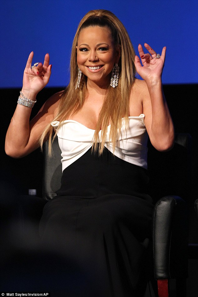 Bling it on: Mariah Carey wearing a black and white gown along with some heavy jewels