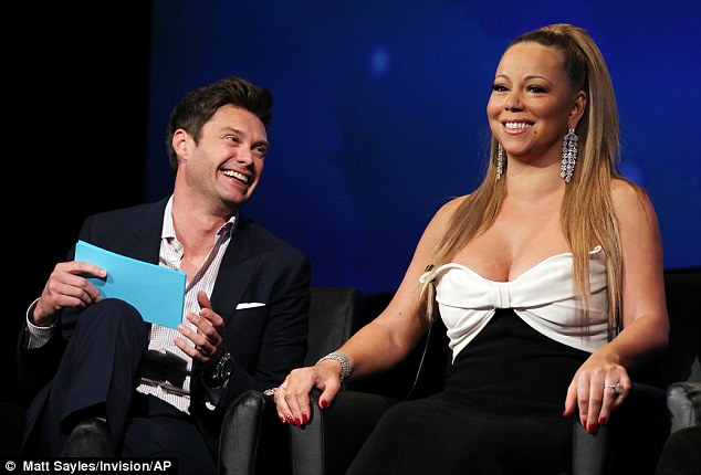 Happy front: Ryan Seacrest seemed to be having an attack of the giggles while Mariah smiled gracefully
