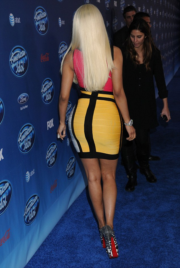 Work of art: Nicki's dress was so tight it looked painted on her body, while her sky-high heels flashed red soles