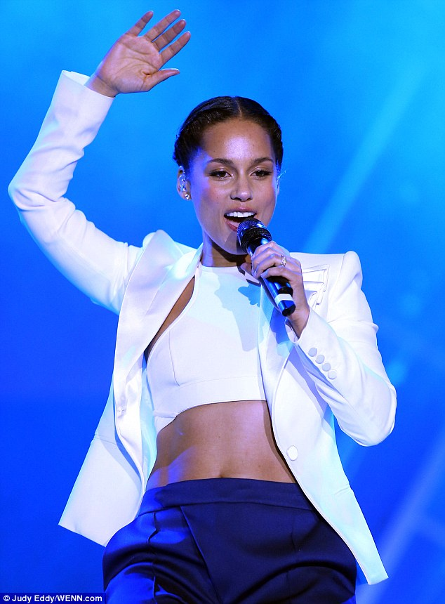 Look at that tummy: Alicia Keys showed off her impressive stomach as she performed in Las Vegas