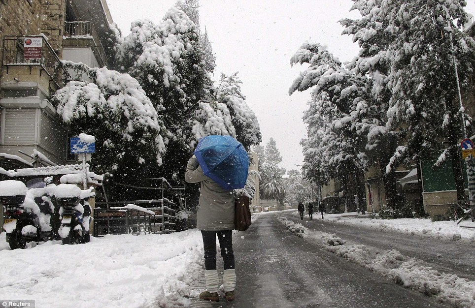 Public transport has ground to a halt after the unusual snowstorm hit Jerusalem