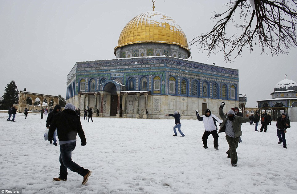 Snowball fights erupt around the Dome of the Rock where up to eight inches has fallen since last night