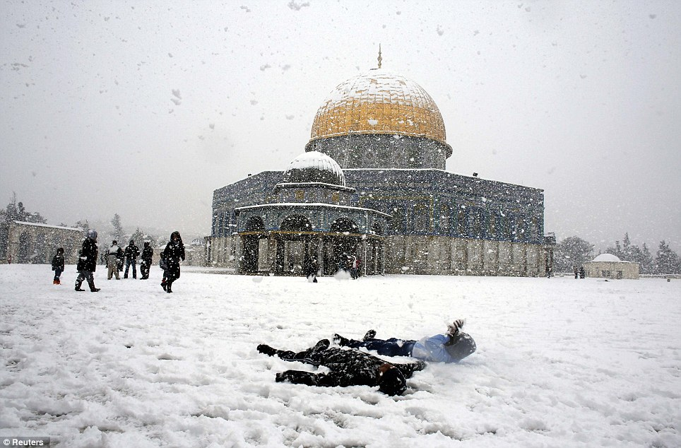Children makes snow angles in the heaviest snowfall to hit Jerusalem since 1992