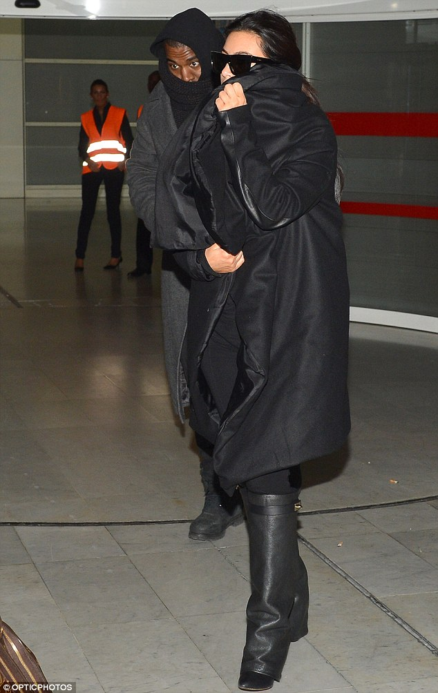 Shiver me timbers: The 31-year-old reality star, who is expecting her first child with the rapper, bundled herself up from the cold European winter in a large black overcoat