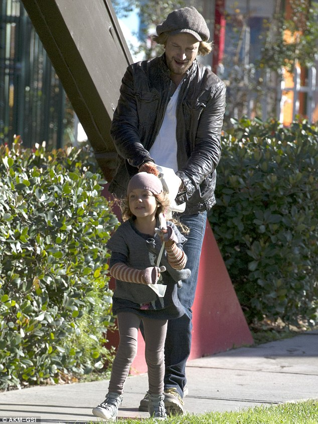 She's got him wrapped around her little finger: Halle Berry's daughter Nahla playfully lead her father Gabriel Aubry with the belt of her coat after-school in Beverly Hills Thursday