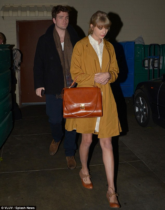 Finding comfort in her family: Taylor Swift was seen leaving a dinner with her brother Austin at Maestros Steakhouse in Beverly Hills on Thursday night following her break-up with One Direction's Harry Styles
