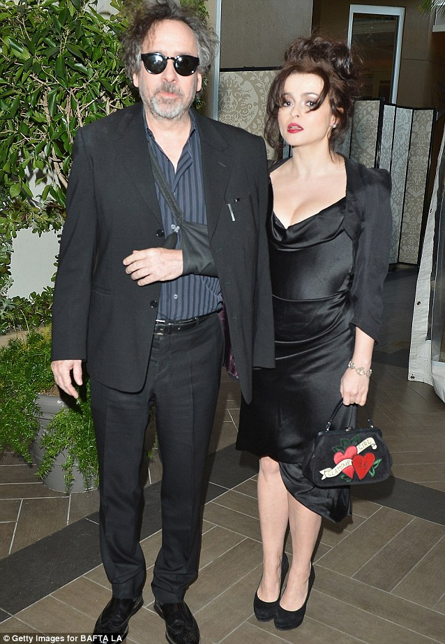 Hot couple: Tim Burton arrived with partner Helena Bonham Carter who looked stunning in a low cut black dress and clutch bag