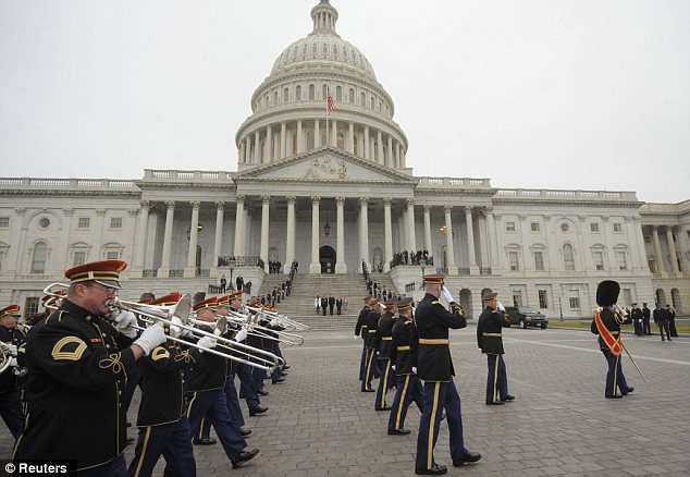 Practice ceremony: Members of the military band pass actors portraying U.S. President Barack Obama, First Lady Michelle Obama, Vice President Joe Biden and his wife Jill Biden as they perform during the dress rehearsal at the U.S. Capitol