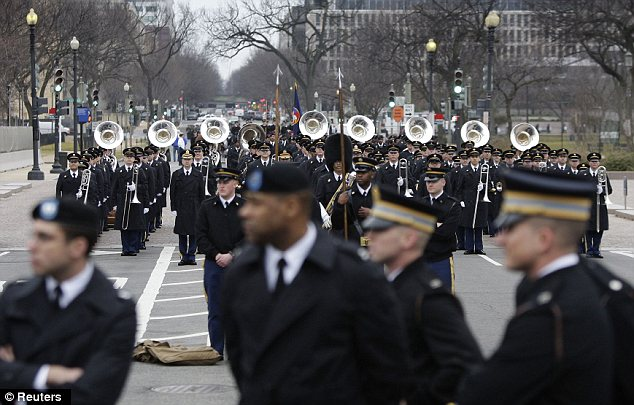 On the scene: A U.S. Army band arrives to take part in the rehearsal