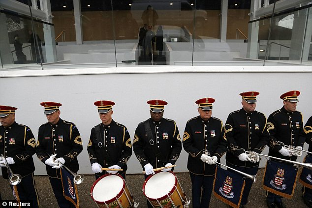 Taking form: U.S. Army trumpeters and drummers take their spots below the presidential reviewing stand