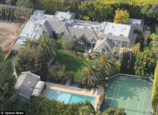 Not exactly a fire sale: Madonna has dropped the price of her Beverly Hills mansion from $28 million to $22.5 million