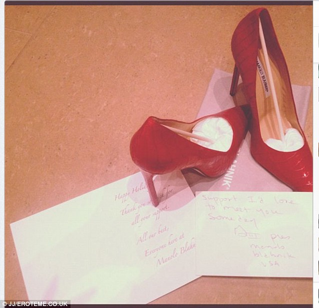 Freebies: The singer shared her gift of red high heels with fans