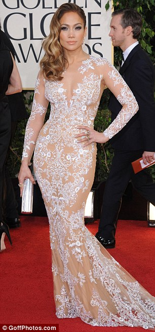Curve-enhancing: The gown clung to Jennifer's figure, and drew attention to her most famous asset - her pert derriere