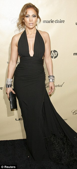 Divine diva: Jennifer looked incredible as she showed off her figure in a plunging black dress for the occasion