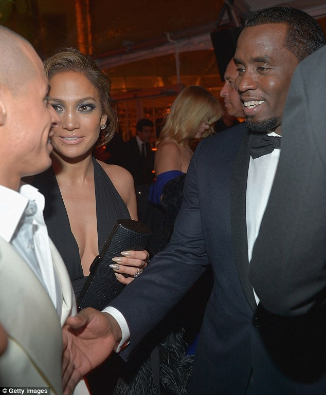 No awkwardness here! Jennifer Lopez introduced her boyfriend Casper Smart to her ex P Diddy at the Weinstein after-party following the Golden Globe awards on Sunday night