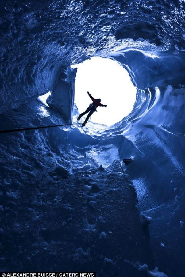 Hulya Vassail climbs out of a moulin ice cave
