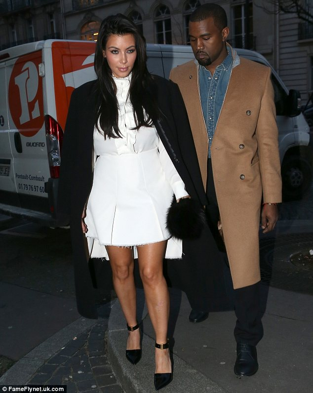 Proud parents-to-be: Kim and boyfriend Kanye West, pictured on Friday in Paris, announced at the end of last month that they are expecting their first child together