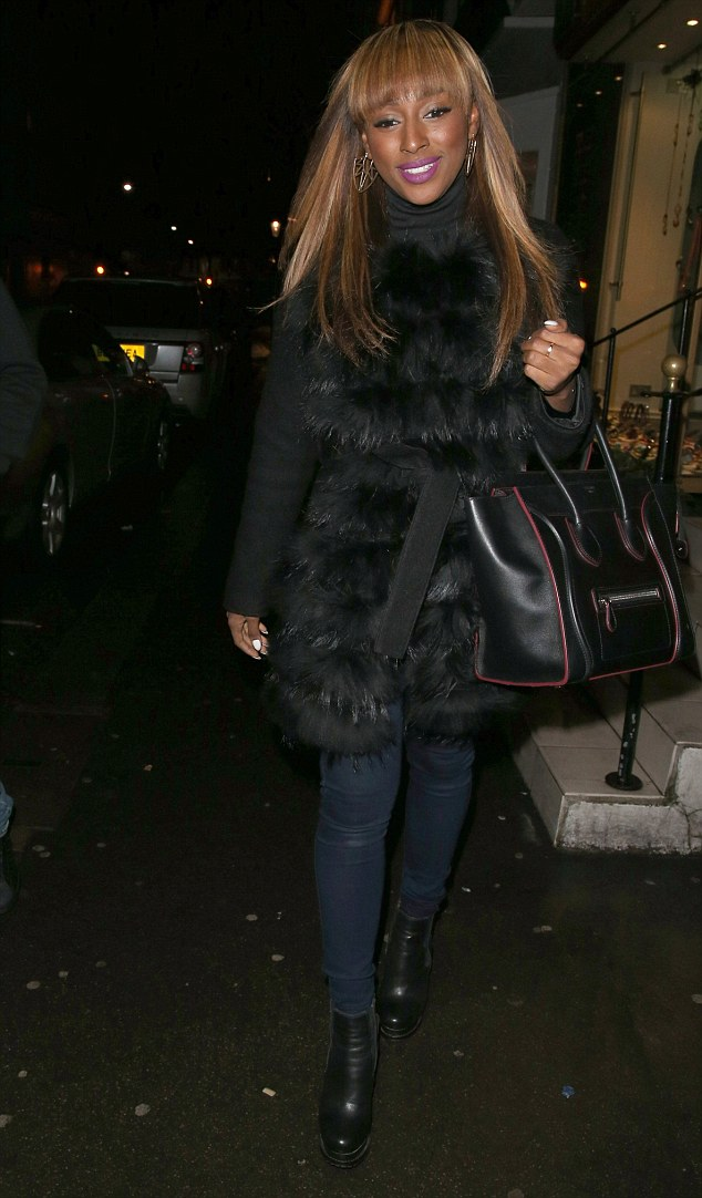 Wrapped up warm: ALexandra Burke was well prepared against the cold when she arrived at the restaurant