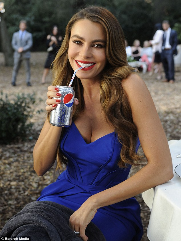 Pepsi girl: Sofia looked amazing in a strapless blue gown with red lipstick as she filmed the recent advert for the drink