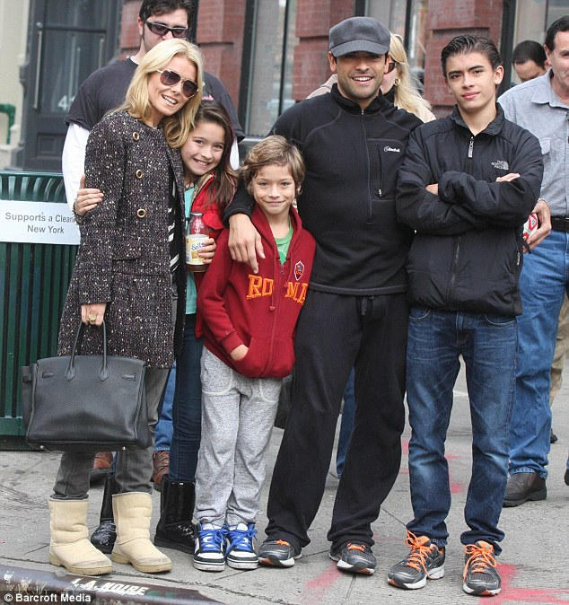 16 years strong: Kelly and her husband Mark Consuelos reside in New York's Soho neighbourhood with their three children - 15-year-old Michael, 11-year-old Lola, and Joaquin, who turns 10 next month